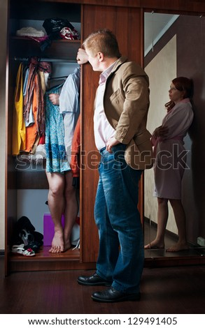 Her husband found the closet lover - stock photo
