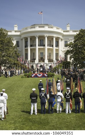 Her Majesty Queen Elizabeth II and President George W. Bush reviewing military branches as they display full dress colors on the South Lawn of the White House May 7, 2007 - stock photo