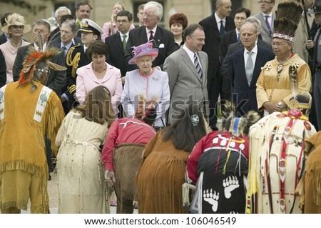 Her Majesty Queen Elizabeth II and Prince Philip, Virginia Governor Timothy M. Kaine and First Lady Anne Holton observing Native American Indian Ceremony, Richmond Virginia, May 3, 2007 - stock photo
