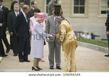 Her Majesty Queen Elizabeth II, Prince Philip and Virginia Governor Timothy M. Kaine meeting Powhatan Tribal Member in front of Virginia State Capitol, Richmond Virginia, May 3, 2007
