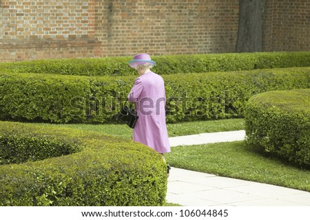 Her Majesty Queen Elizabeth II walking alone down sidewalk to Governor's Palace in Williamsburg Virginia, as part of the 400th anniversary of the English Settlement of Jamestown, Virginia, May 4, 2007 - stock photo