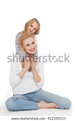 Her motivation. Studio portrait of a happy mother and daughter posing looking to the camera smiling on white background. - stock photo