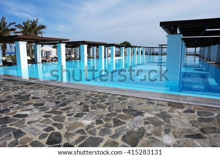 HERAKLION, CRETE, GREECE - MAY 13, 2014: The big blue swimming-pool with columns in luxury class hotel May 13, 2014, Greece.