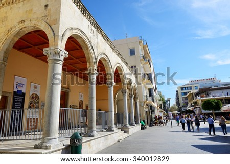 HERAKLION, GREECE - MAY 12: The street in Herakllion city and tourists on May 12, 2014 in Heraklion, Greece. Up to 16 mln tourists is expected to visit Greece in year 2014. - stock photo