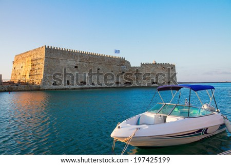 Heraklion harbour with old venetian fort and boat, Crete, Greece - stock photo