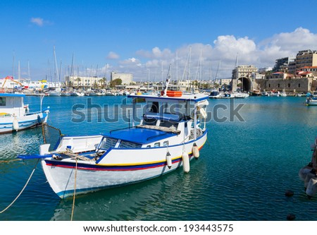 Heraklion old port with colorful boats, Crete, Greece - stock photo