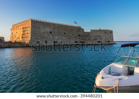 Heraklion old venetian harbour with old venetian fort and boat, Crete, Greece - stock photo