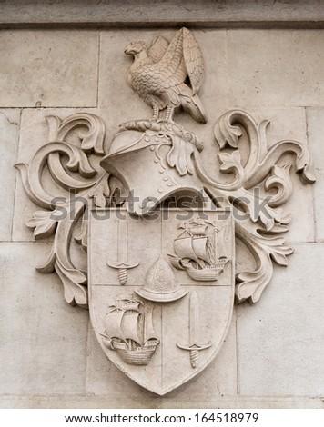 Heraldic shield stone in a pareto - stock photo