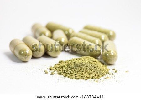 herb capsule on white background - stock photo