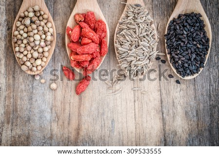 Herb ingredient for cooking on wooden spoon - stock photo