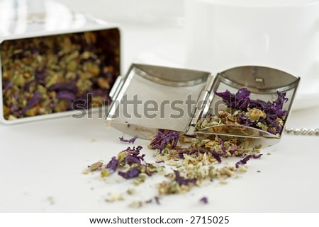 Herb tea with cup and cake on bright background