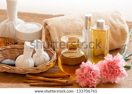 Herbal and oil treatment equipment in relaxing spa setting. - stock photo