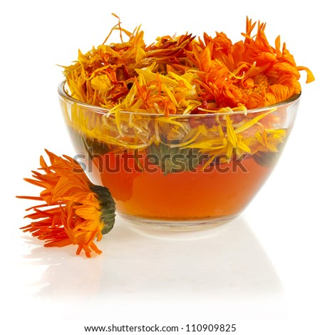 herbal calendula in the glass  Isolated white background - stock photo