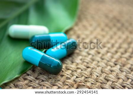 Herbal capsule medicine - stock photo