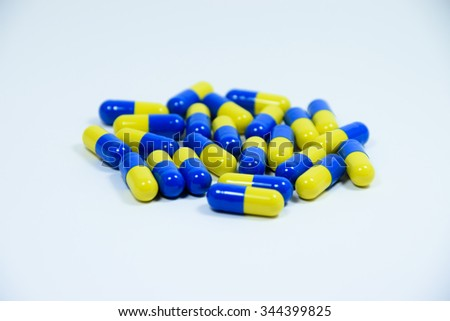 herbal capsule medicine on white background