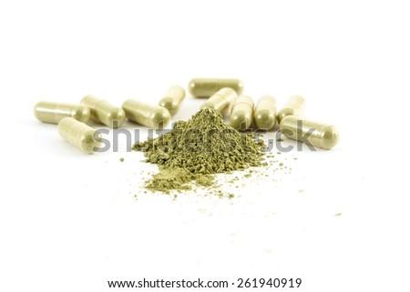 Herbal capsule on white background. - stock photo