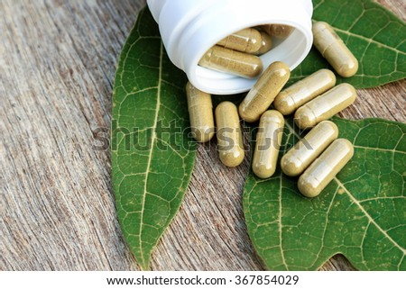 Herbal capsules from ginger on bottle. herbal medicines for healthy living.  - stock photo