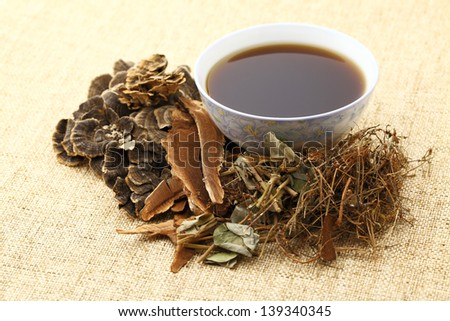 Herbal drink on the linen table - stock photo