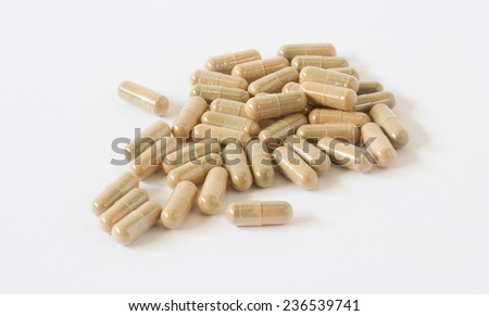 Herbal drug, alternative medicine in capsule - stock photo