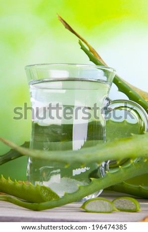 Herbal medicine: Beverage with Aloe vera juice - stock photo