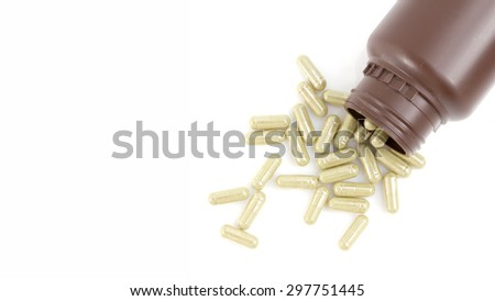 Herbal medicine capsules on white background with copy space. - stock photo