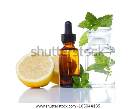 Herbal medicine dropper bottle with lemon and mint - stock photo