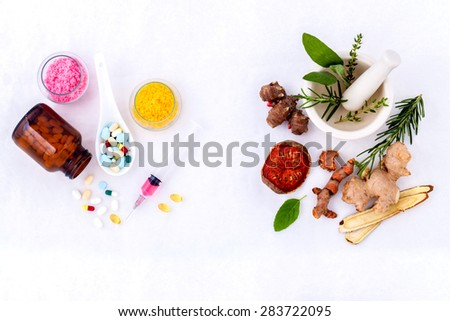 Herbal medicine VS Chemical medicine the alternative healthy care on white background. - stock photo