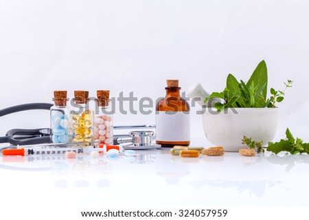 Herbal medicine VS Chemical medicine the alternative healthy care with stethoscope isolate on white background. - stock photo
