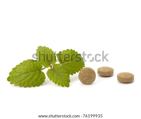 Herbal pills isolated on white background. Alternative medicine concept.