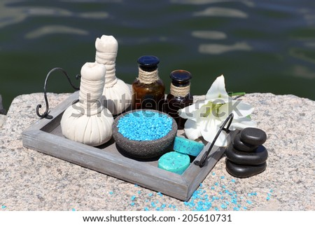 Herbal remedies for massage, on wooden tray, outdoor  - stock photo