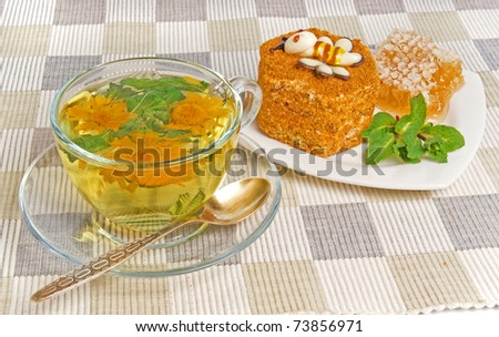 herbal tea and cake on textile mat
