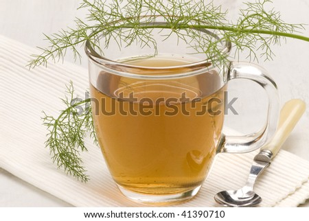 Herbal tea.Fennel infusion in a glass cup.Foeniculum vulgare.Naturopathy.Selective focus.