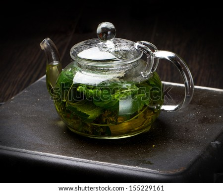 Herbal tea in a glass teapot, side view