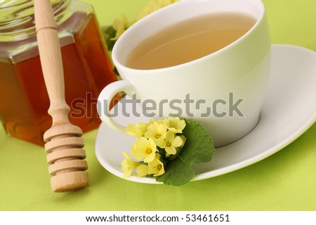Herbal tea made from freshly picked primroses with honey