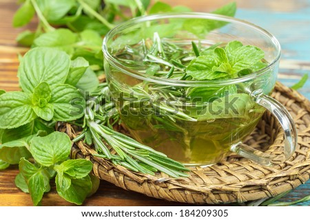 Herbal tea. Rosemary Mint Tea with fresh rosemary and mint leaves. Phytotherapy plants and medical herbs. Macro, selective focus - stock photo