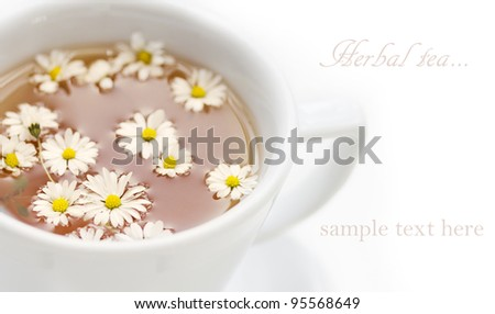 herbal tea with chamomile isolated on white ,shallow dof - stock photo