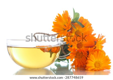 Herbal tea with marigold flowers on a white background