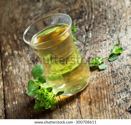 Herbal tea with oregano, selective focus