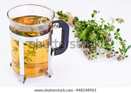 Herbal Tea with Thyme, Mint and Cinnamon on Wooden Rustic Background Studio Photo