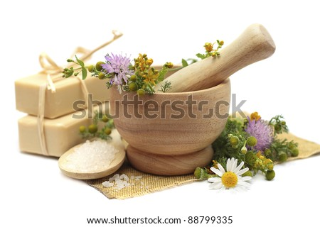 Herbal treatment - camomile, tutsan and cosmetics - stock photo