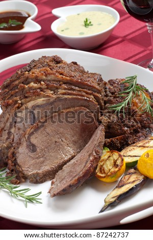 Herbed Rib Eye with grilled vegetables and two sauces. - stock photo
