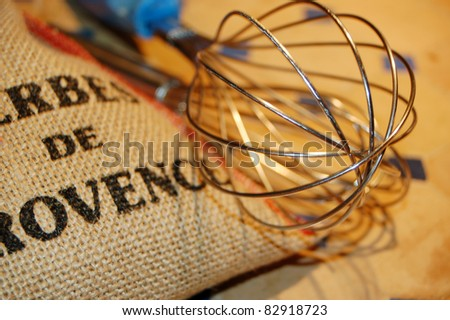 Herbes de Provence - mixed herbs with wire whisk - stock photo