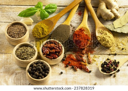 Herbs and spices composition. Cooking ingredients on a wooden table - stock photo