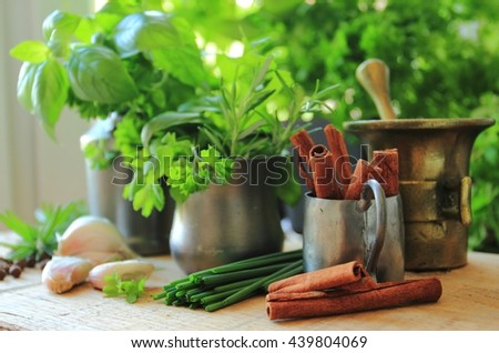 Herbs and spices in rustic pots and jugs