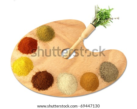 Herbs and spices on a wooden palette - stock photo