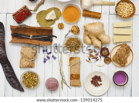 herbs and spices on white wood table - stock photo