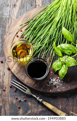 Herbs and spices on wooden board - cooking, healthy or vegetarian food concept - stock photo