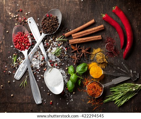 Herbs and spices on wooden table. Top view - stock photo