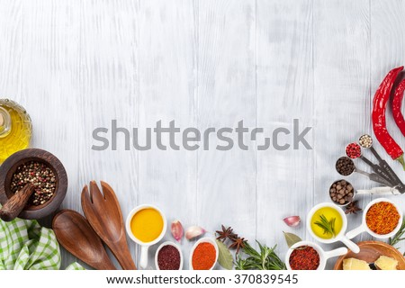 Herbs and spices over wood background. Top view with copy space - stock photo