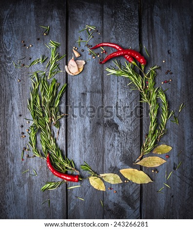 Herbs and spices round frame on blue wooden background, top view, place for text - stock photo